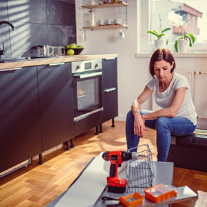 woman sitting on a box